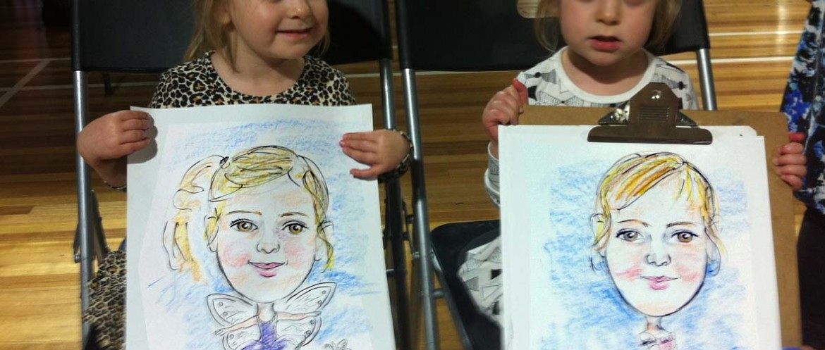 The twins were beautiful and enjoyed their cartoon portraits